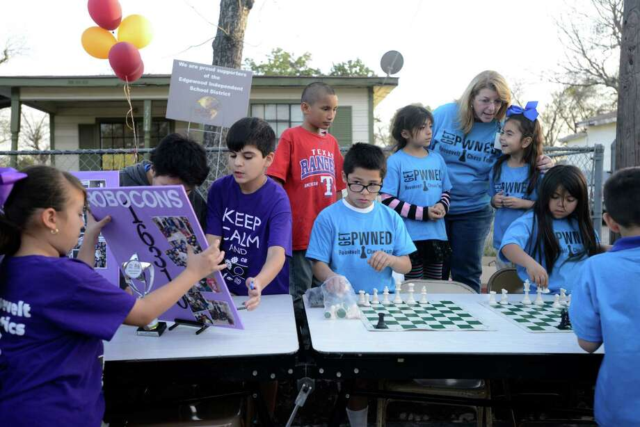 Roosevelt Elementary School students involved in robotics and chess attend the Edgewood Independent School District neighborhood meeting on Thursday, Feb. 20, 2014. Photo: Billy Calzada, San Antonio Express-News / San Antonio Express-News