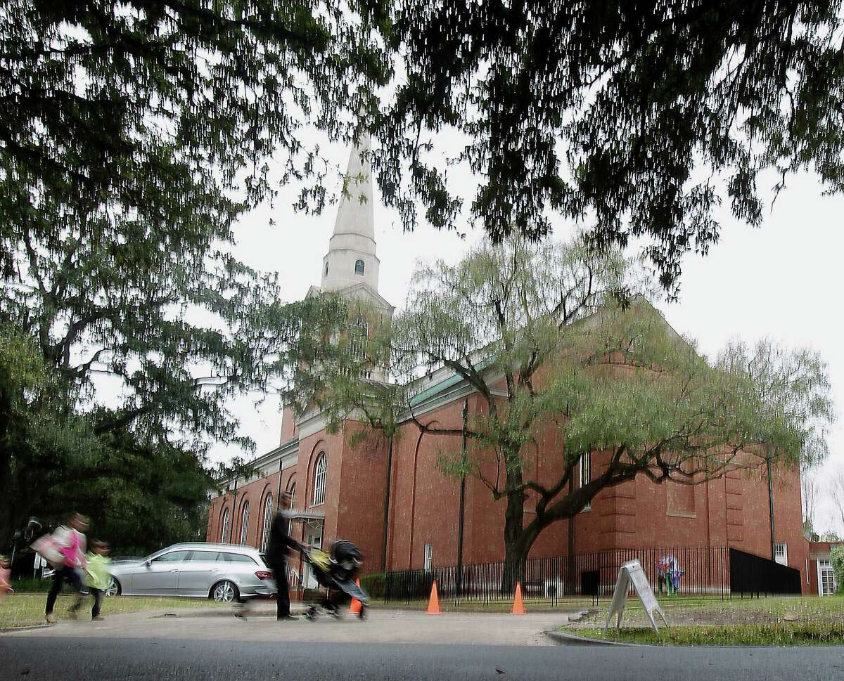 People arrive at First Presbyterian Church, today members are voting whether to leave its current denomination for a new one Sunday, Feb. 23, 2014, in Houston.