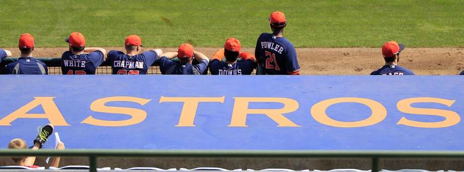 Players in the dugout during the Astros' intra-squad game at the Osceola County Stadium on Sunday. Photo: Karen Warren, Houston Chronicle