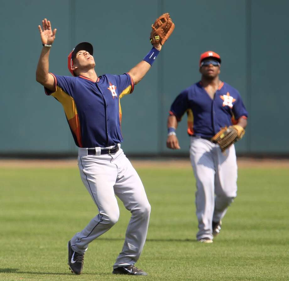 Carlos Correa signals that he's got a pop fly hit by Jesus Guzman as they played in an intra-squad game. Photo: Karen Warren, Houston Chronicle
