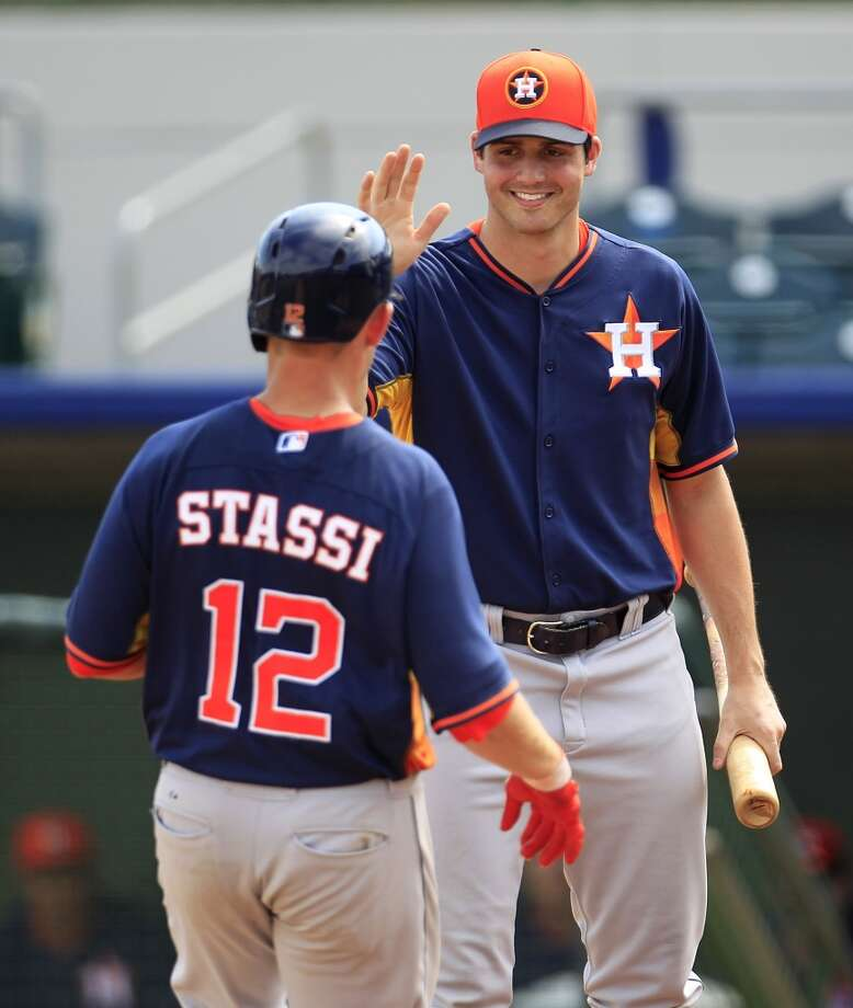 Mark Appel greets catcher Max Stassi at home after Stassi's home run. Photo: Karen Warren, Houston Chronicle