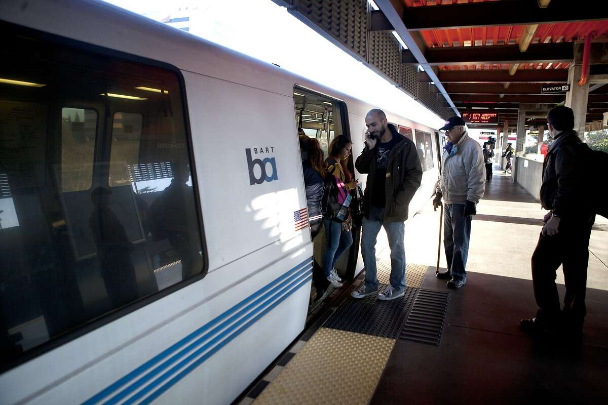 BART riders file on and off of the first BART train to stop at the Concord station following a train jumping the tracks last Friday, in Concord Calif. on Feb. 23, 2014.