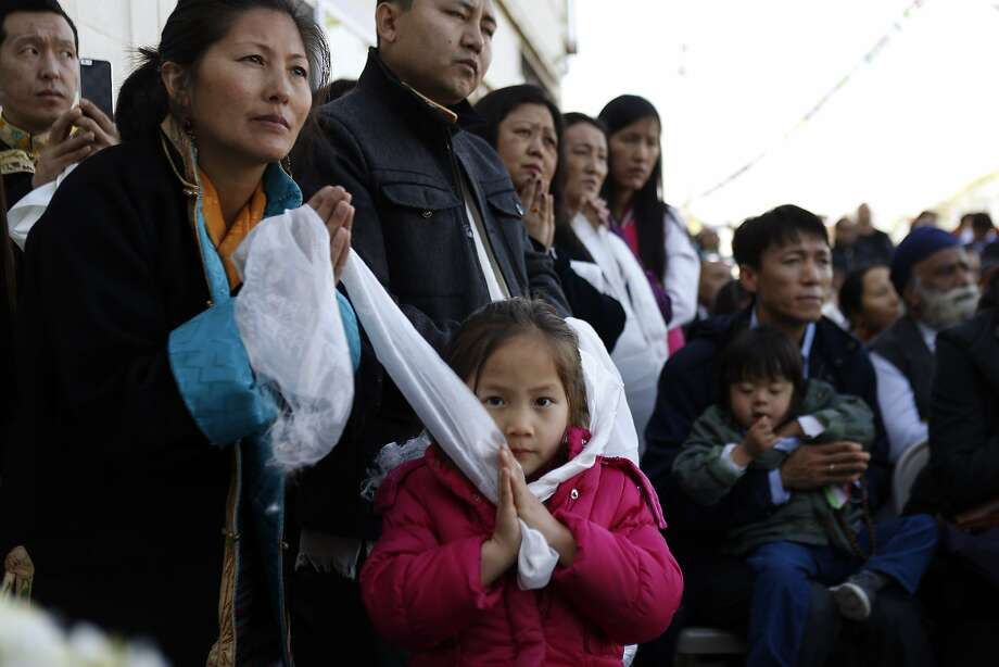 Members of the Tibetan community listen as the Dalai Lama speaks to the crowd at the Tibetan Association of Northern California on Sunday. The TANC hosted His Holiness the 14th Dalai Lama as hundreds of members of the Tibetan community gathered to see their spiritual leader on Sunday, February 23, 2014, in Richmond, Calif. His Holiness met with Bay Area Tibetans and consecrated the prayer hall in the TANC. Photo: Carlos Avila Gonzalez, The Chronicle
