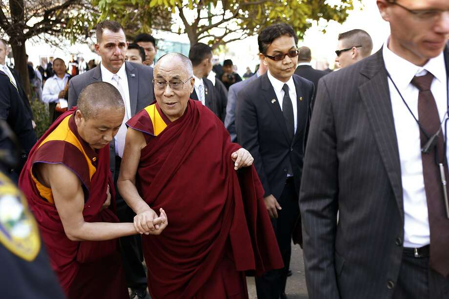 The Dalai Lama is assisted to his car as he departs the Tibetan Association of Northern California after meeting with the Tibetan community on Sunday. The TANC hosted His Holiness the 14th Dalai Lama as hundreds of members of the Tibetan community gathered to see their spiritual leader on Sunday, February 23, 2014, in Richmond, Calif. His Holiness met with Bay Area Tibetans and consecrated the prayer hall in the TANC. Photo: Carlos Avila Gonzalez, The Chronicle