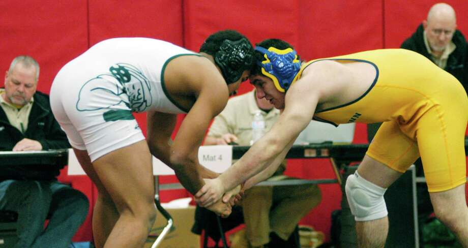 Denzel Phillips of the Green Wave battles Greg LaRussa of Newtown in the 182-pound weight class final for New Milford High School wrestling during the South-West Conference championship tournament at Pomperaug High School in Southbury, Feb.16, 2014. Photo: Norm Cummings / The News-Times