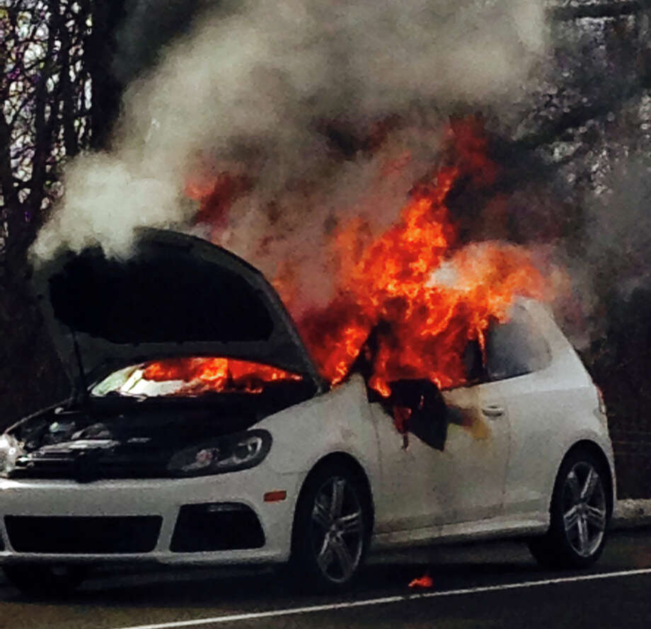 A Volkswagen Golf is consumed by flames after catching fire Sunday on Interstate 95's northbound entrance ramp at the Exit 19 interchange. Photo: Fairfield Fire Department / Fairfield Citizen contributed