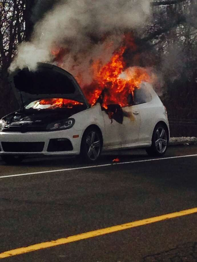 A driver narrowly escaped injury, but a 2013 Volkswagen was destroyed when it burst into flames on an exit ramp along Interstate 95, Feb. 23, 2014. Photo: Contributed / Connecticut Post contributed