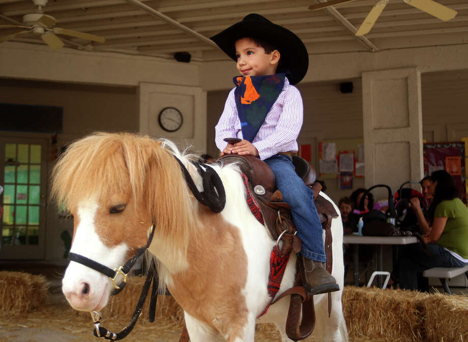 Discovery School student Andres Barrera, 4, got into the spirit of things during the schoolÕs Rodeo Roundup held Feb. 19-20 at the North Central San Antonio campus. Students enjoyed square dancing, a cowboy breakfast, stick horse races and other Western-style activities. Photo: Courtesy Photo