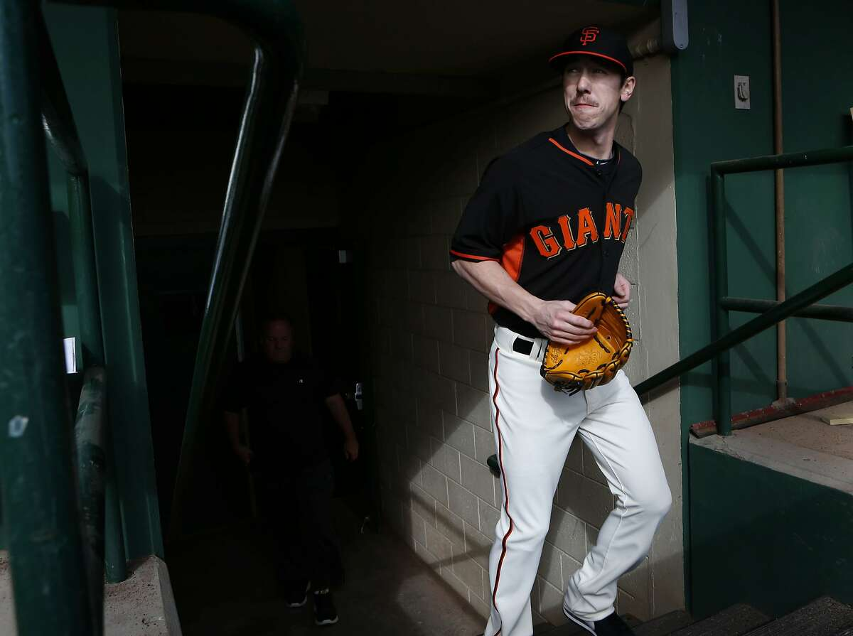 Giants' pitcher Tim Lincecum takes the field for morning workouts at Scottsdale Stadium in Scottsdale, Arizona on Sunday Feb. 23, 2014.