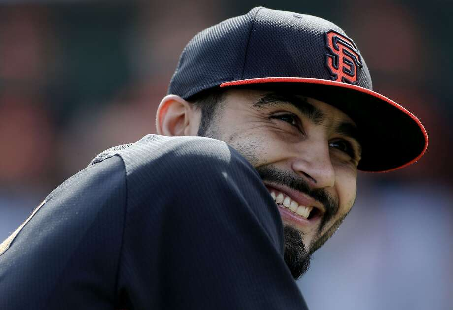 Giants' pitcher Sergio Romo, (54) always seems to have on a smile during practice at Scottsdale Stadium in Scottsdale, Arizona on Friday Feb. 21, 2014. The San Francisco Giants continue their spring training schedule in the Arizona desert in preparation for the 2014 MBL season. Photo: Michael Macor, The Chronicle