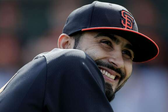 Giants' pitcher Sergio Romo, (54) always seems to have on a smile during practice at Scottsdale Stadium in Scottsdale, Arizona on Friday Feb. 21, 2014. The San Francisco Giants continue their spring training schedule in the Arizona desert in preparation for the 2014 MBL season.