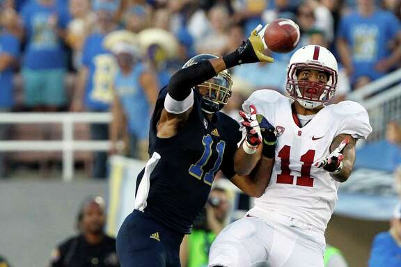 UCLA linebacker Anthony Barr, left, is a possibility if the Texans decide to pass on drafting a quarterback and trade down a few spots in the first round.