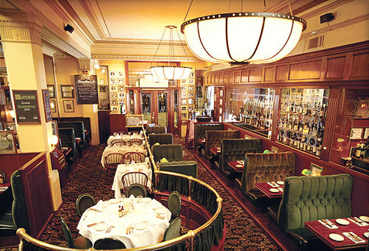 Metropolitan Grill: Here, you're greeted with mahogany, brass and a glass case filled with cuts of beef. Classy all the way.