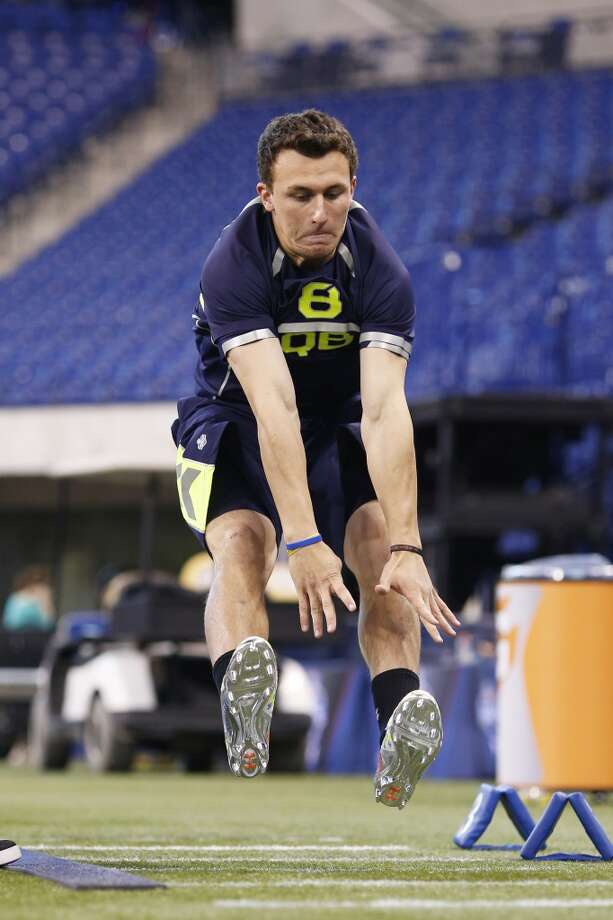 Former Texas A&M quarterback Johnny Manziel takes part in the broad jump. Photo: Joe Robbins, Getty Images