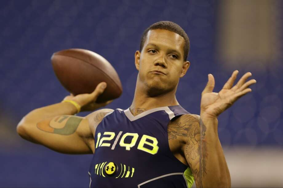 Miami quarterback Stephen Morris throws during a drill. Photo: Michael Conroy, Associated Press