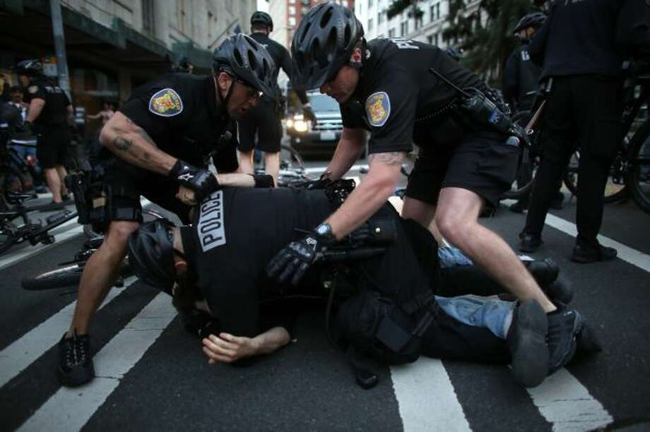 Seeing a police officer roughing up a protester.