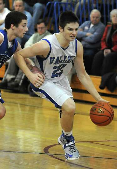 Hoosic Valley's John Rooney dribbles the ball during a basketball game against Hoosick Falls on Thur