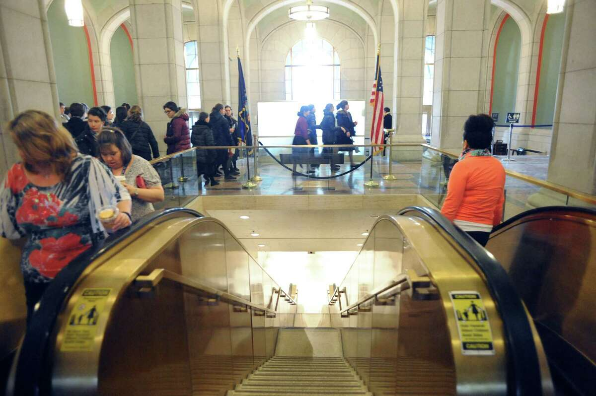 People make their way between the Empire State Plaza Concourse and Capitol building on Thursday, Feb. 20, 2014, in Albany, N.Y. (Michael P. Farrell/Times Union)