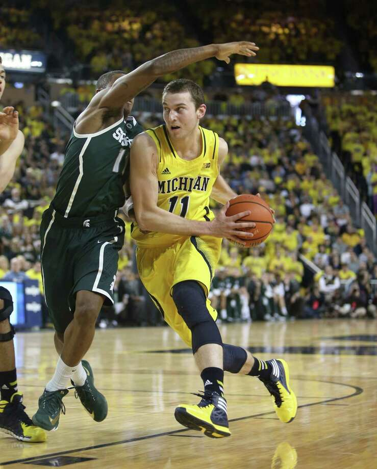 Nik Stauskas, whose 25 points helped Michigan pull away from Michigan State, drives on Keith Appling. Photo: Kirthmon F. Dozier, MBR / Detroit Free Press