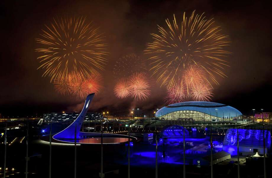 Fireworks explode over Olympic Park during the closing ceremony of the 2014 Winter Olympics on Sunday in Sochi, Russia. Photo: Matt Slocum / Associated Press / AP