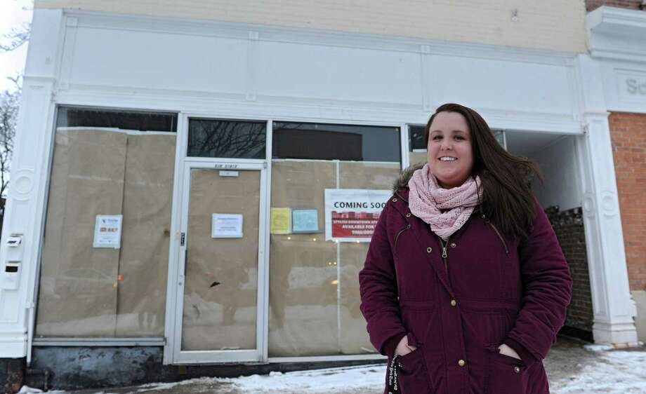 Sara Mae Hickey, founder and president of The Autism Initiative, stands in front of the construction site for Puzzles Bakery & Cafe on State St. on Wednesday, Feb. 19, 2014, in Schenectady, N.Y. The cafe, which will open in the Spring, will be a place for adults with autism to work. Sara Mae's sister is on the autism spectrum.  (Lori Van Buren / Times Union) Photo: Lori Van Buren / 00025786A