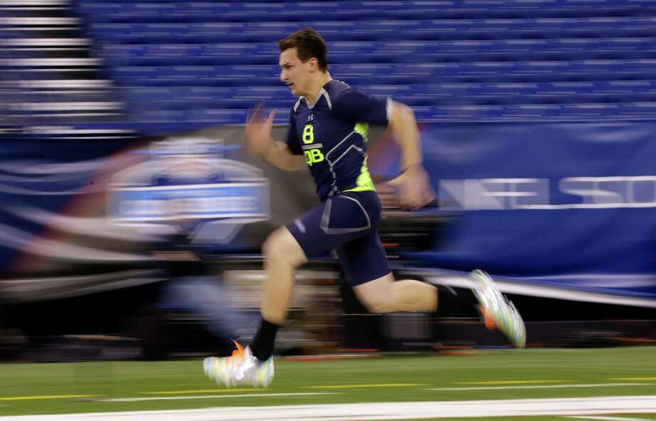 Johnny Manziel wasn't particularly impressive in running the 40-yard dash in 4.68 seconds Sunday, but he gained points with teams for his businesslike approach during individual interviews. Photo: Michael Conroy, STF / AP
