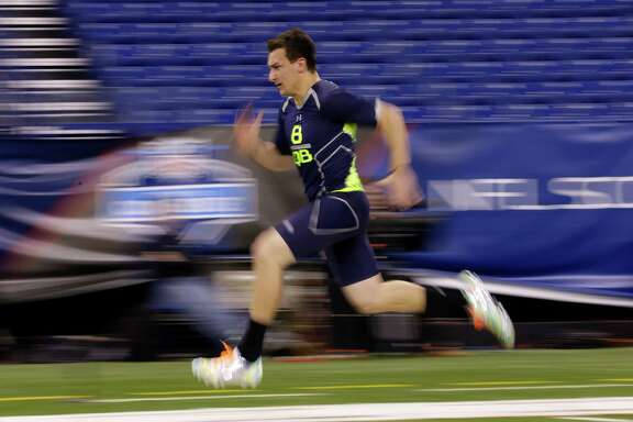 Johnny Manziel wasn't particularly impressive in running the 40-yard dash in 4.68 seconds Sunday, but he gained points with teams for his businesslike approach during individual interviews.