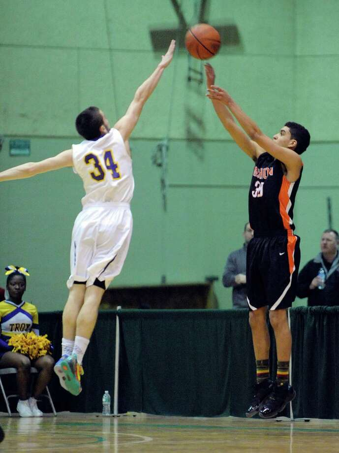Connor Nicoll of Troy, left, tries to block the shot of Donye Walker of Mohonasen  during their game on Sunday, Feb. 23, 2014 in Troy, NY.     (Paul Buckowski / Times Union) Photo: Paul Buckowski / 00025834A