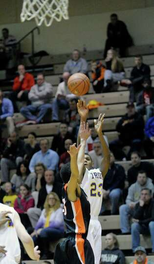 Maurice Watson of Troy puts up a shot over a Mohonasen defender  during their game on Sunday, Feb. 2