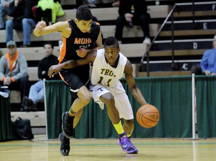 Donye Walker of Mohonasen, left, tries to stop Dyaire Holt of Troy  during their game on Sunday, Feb