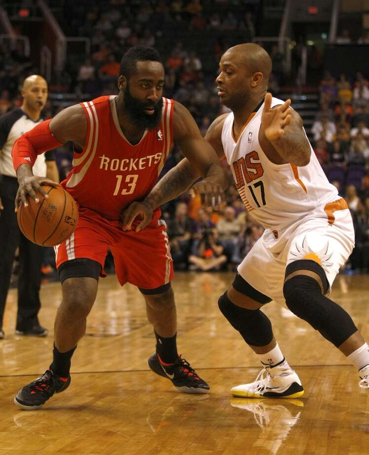 Rockets shooting guard James Harden (13) drives on Suns small forward P.J. Tucker. Photo: Rick Scuteri, Associated Press