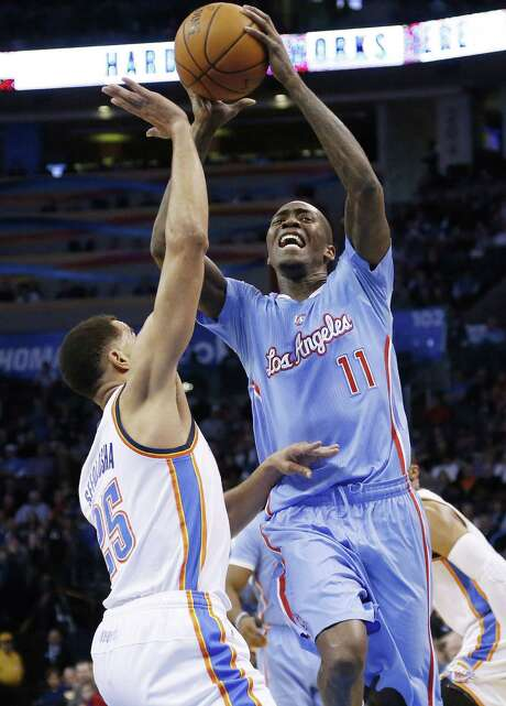 Clippers guard Jamal Crawford takes a shot against the Thunder's Thabo Sefolosha en route to scoring 36 points. He made 5 of 8 from 3-point range. Photo: Sue Ogrocki / Associated Press / AP