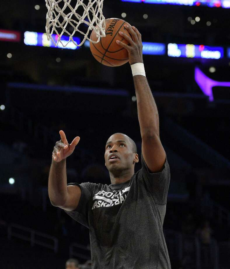 Nets center Jason Collins, who returned to the team he helped to two NBA Finals appearances, had two rebounds in a win over the Lakers on Sunday. Photo: Mark J. Terrill / Associated Press / AP