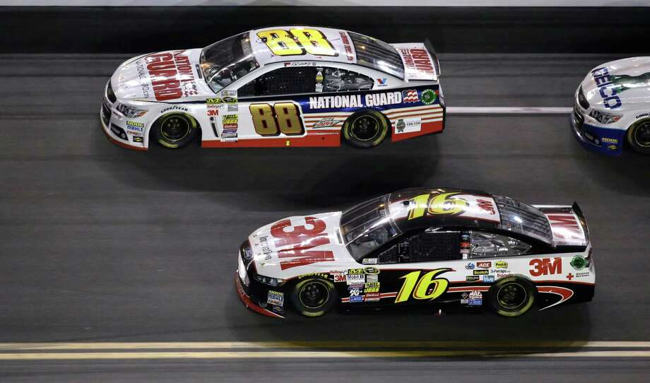 Dale Earnhardt Jr. (88) and Greg Biffle (16) race during the NASCAR Daytona 500 Sprint Cup series auto race at Daytona International Speedway in Daytona Beach, Fla., Sunday, Feb. 23, 2014. (AP Photo/John Raoux) ORG XMIT: DBR151 Photo: John Raoux / AP