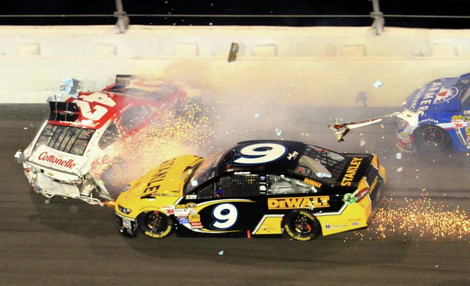 Kyle Larson (42) and Marcos Ambrose (9) crash during the NASCAR Daytona 500 Sprint Cup series auto race at Daytona International Speedway in Daytona Beach, Fla., Sunday, Feb. 23, 2014. (AP Photo/John Chilton) ORG XMIT: DBR153 Photo: John Chilton / FR170591 AP