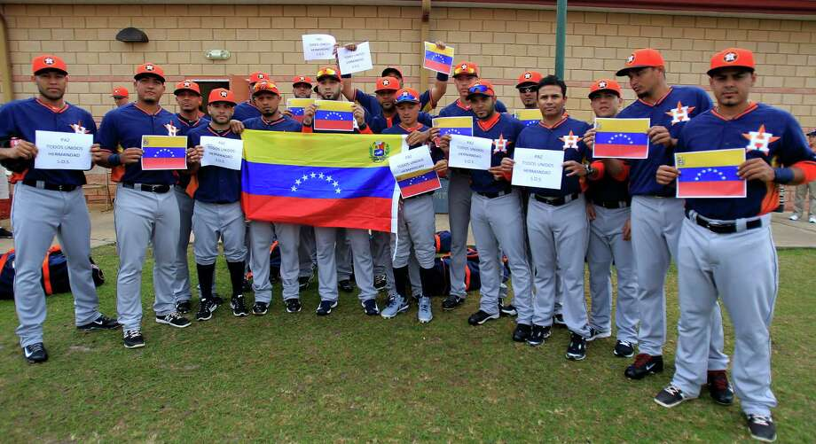 The Astros' seven Venezuelan players and several teammates join Sunday to plead for peace in the South American country. Photo: Karen Warren, Staff / © 2013 Houston Chronicle