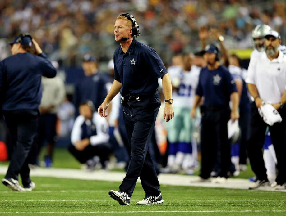 "Despite the hiring of Bill Callahan as offensive coordinator last season, Cowboys owner Jerry Jones revealed Sunday that coach Jason Garrett (above) ""was really your coordinator last year."" Photo: Ronald Martinez / Getty Images / 2013 Getty Images"