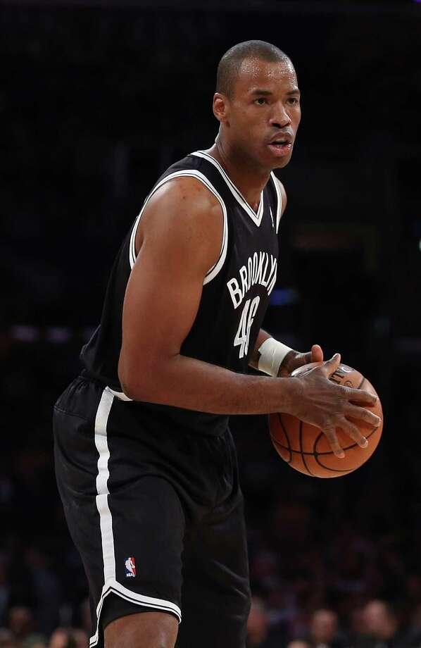 LOS ANGELES, CA - FEBRUARY 23:  Jason Collins #98 of the Brooklyn Nets handles the ball in the first half against the Los Angeles Lakers at Staples Center on February 23, 2014 in Los Angeles, California. NOTE TO USER: User expressly acknowledges and agrees that, by downloading and or using this photograph, User is consenting to the terms and conditions of the Getty Images License Agreement.  (Photo by Jeff Gross/Getty Images) ORG XMIT: 182419323 Photo: Jeff Gross / 2014 Getty Images