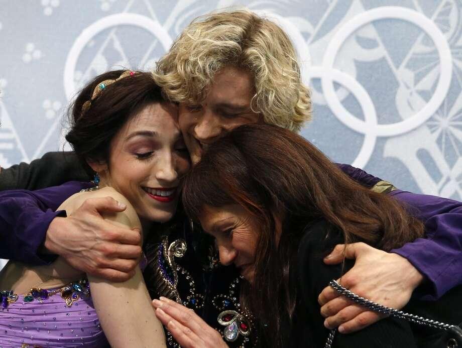 US Charlie White and US Meryl Davis celebrate in the kiss and cry zone after the Figure Skating Ice Dance Free Dance at the Iceberg Skating Palace during the Sochi Winter Olympics on February 17, 2014. Photo: ADRIAN DENNIS, AFP/Getty Images