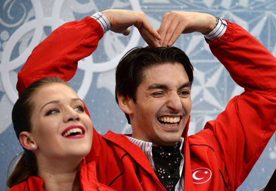 "Turkey's Alisa Agafonova and Alper Ucar wait for their marks in the ""kiss and cry"" zone during the Figure Skating Ice Dance Short Dance at the Iceberg Skating Palace during the Sochi Winter Olympics on February 16, 2014. AFP PHOTO / YURI KADOBNOVYURI KADOBNOV/AFP/Getty Images Photo: YURI KADOBNOV, AFP/Getty Images"
