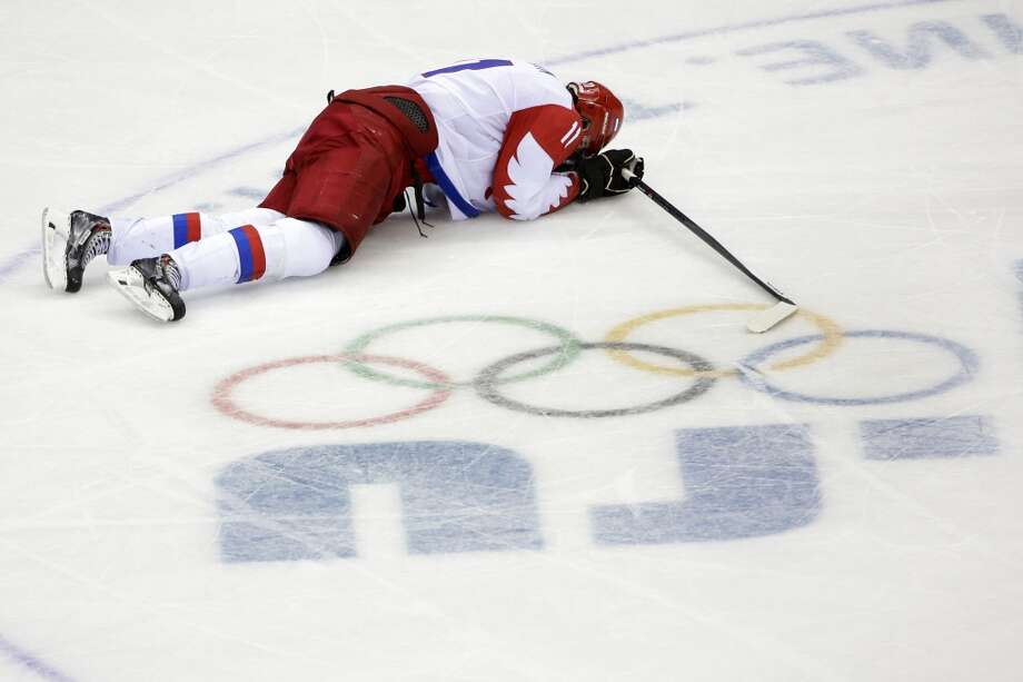 Russia forward Yevgeni Malkin lies on the ice in the closing minutes of the third period in men's quarterfinal hockey game against Finland at Bolshoy Arena at the 2014 Winter Olympics, Wednesday, Feb. 19, 2014, in Sochi, Russia. Finland defeated Russia 3-1. Photo: David J. Phillip, Associated Press