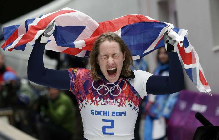 Elizabeth Yarnold of Britain celebrates her gold medal win during the women's skeleton competition at the 2014 Winter Olympics, Friday, Feb. 14, 2014, in Krasnaya Polyana, Russia. Photo: Michael Sohn, Associated Press