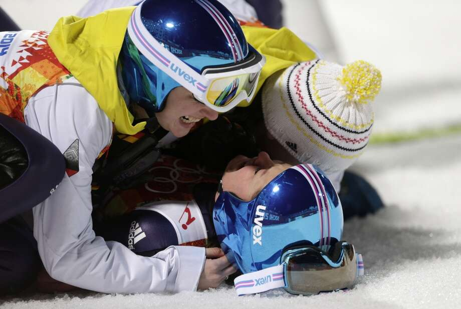 Germany's Carina Vogt is congratulated by teammates after winning the gold during the women's normal hill ski jumping final at the 2014 Winter Olympics, Tuesday, Feb. 11, 2014, in Krasnaya Polyana, Russia. Photo: Matthias Schrader, Associated Press