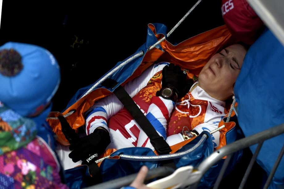 France's Marie Laure Brunet is stretchered away at the start of the Women's Biathlon 4x6 km Relay at the Laura Cross-Country Ski and Biathlon Center during the Sochi Winter Olympics on February 21, 2014, in Rosa Khutor, near Sochi. Photo: ODD ANDERSEN, AFP/Getty Images