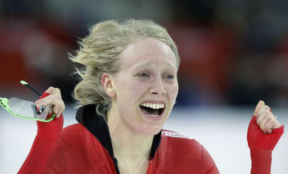 Norway's Mari Hemmer celebrates her performance in the women's 5,000-meter speedskating race at the Adler Arena Skating Center during the 2014 Winter Olympics in Sochi, Russia, Wednesday, Feb. 19, 2014. Photo: Matt Dunham, Associated Press