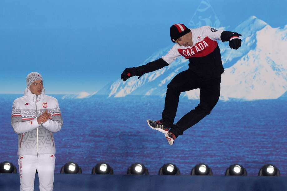 A picture taken with a robotic camera shows (from L) Poland's gold medalist Zbigniew Brodka and Canada's bronze medalist Denny Morrison posing during the Men's Speed Skating 1500 m Medal Ceremony at the Sochi medals plaza during the Sochi Winter Olympics on February 16, 2014. Photo: ANTONIN THUILLIER, AFP/Getty Images