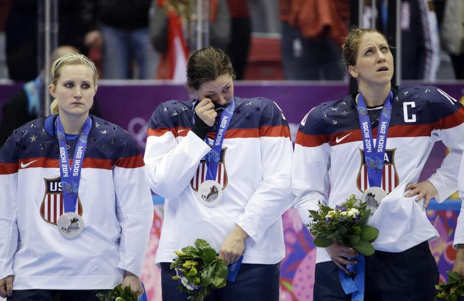USA players react after losing the gold medal women's ice hockey game to Canada 3-2 in overtime at the 2014 Winter Olympics, Wednesday, Feb. 19, 2014, in Sochi, Russia. Photo: David Goldman, Associated Press