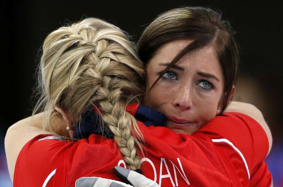 Britain's skip Eve Muirhead, right, embraces Anna Sloan after defeating Switzerland to win the women's curling bronze medal at the 2014 Winter Olympics, Thursday, Feb. 20, 2014, in Sochi, Russia. Photo: Robert F. Bukaty, Associated Press