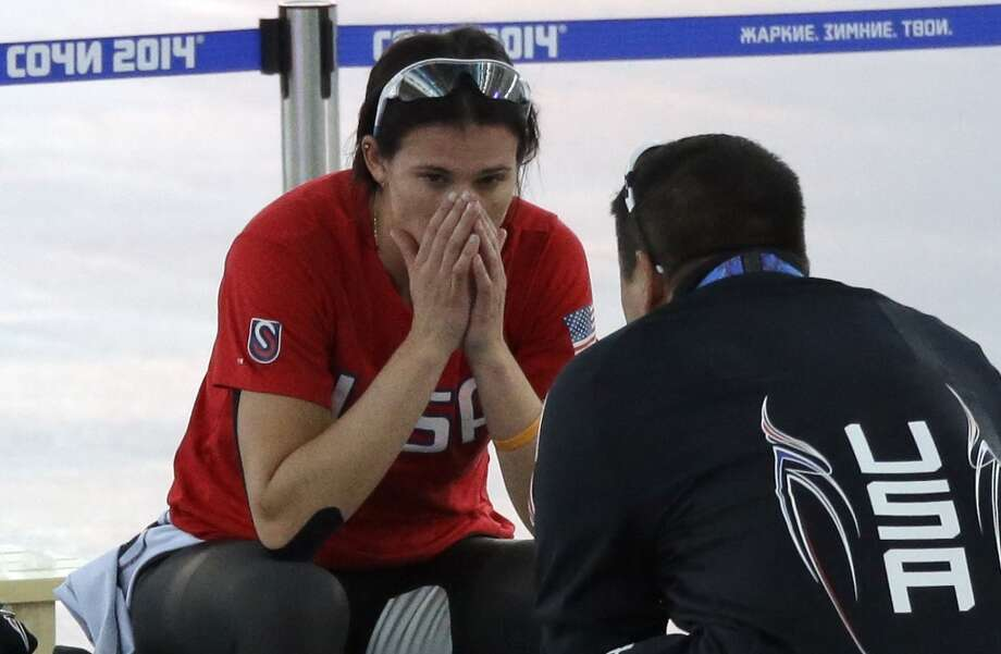 Brittany Bowe of the U.S. sits with coach Ryan Shimabukuro after the women's 1,500-meter speedskating race at the Adler Arena Skating Center during the 2014 Winter Olympics in Sochi, Russia, Sunday, Feb. 16, 2014. Photo: David J. Phillip, Associated Press