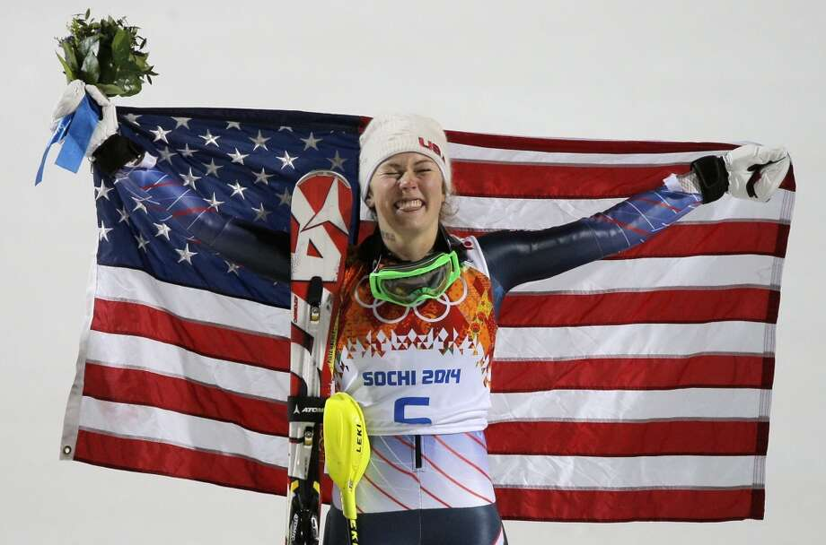 Women's slalom gold medal winner Mikaela Shiffrin of the United States poses for photographers with the American flag at the Sochi 2014 Winter Olympics, Friday, Feb. 21, 2014, in Krasnaya Polyana, Russia. Photo: Christophe Ena, Associated Press